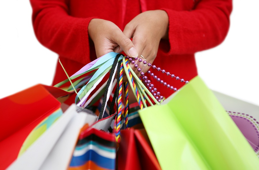 woman holding bags during the holiday shopping season